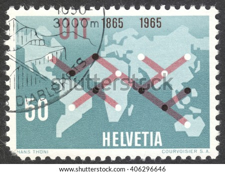 MOSCOW, RUSSIA - CIRCA APRIL, 2016: a post stamp printed in SWITZERLAND shows world map with symbolic telecommunication connections, circa 1965 - stock photo