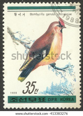 "MOSCOW, RUSSIA - CIRCA APRIL, 2016: a post stamp printed in the NORTH KOREA shows a bird Bombycilla garrulus centralasiae, the series ""Birds"", circa 1988 - stock photo"
