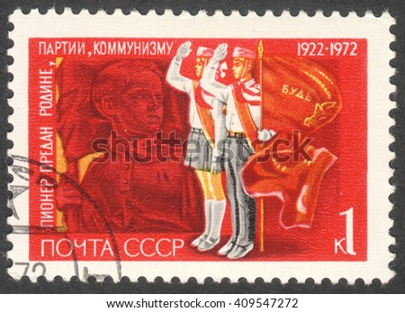 """MOSCOW, RUSSIA - CIRCA APRIL, 2016: a post stamp printed in the USSR shows pioneers, the series """"The 50th Anniversary of Pioneer Organization"""" - stock photo"""