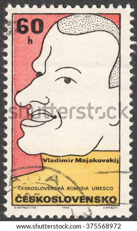 "MOSCOW, RUSSIA - CIRCA FEBRUARY, 2016: a post stamp printed in CZECHOSLOVAKIA shows a portrait of  V.Mayakovsky, the series ""UNESCO - Cultural Personalities of the 20th Cent in Caricature"", circa 1969 - stock photo"