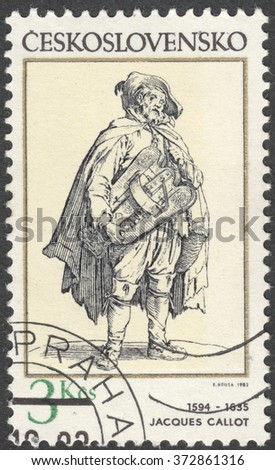 "MOSCOW, RUSSIA - CIRCA FEBRUARY, 2016: a post stamp printed in CZECHOSLOVAKIA shows painting ""Beggar with Viol"" by Jacques Callot, the series ""Engravings with a Music Theme"", circa 1982"