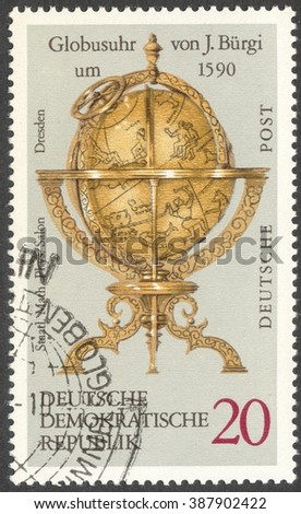 "MOSCOW, RUSSIA - CIRCA FEBRUARY, 2016: a post stamp printed in DDR shows Globe clock by J. Burgi, the series ""Globes"", circa 1972 - stock photo"