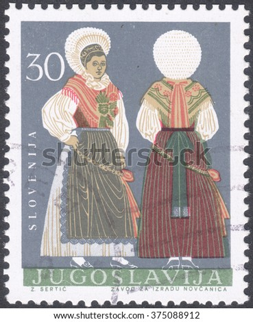 "MOSCOW, RUSSIA - CIRCA FEBRUARY, 2016: a post stamp printed in YUGOSLAVIA shows traditional costumes, the series ""Regional Costumes"", circa 1964 - stock photo"