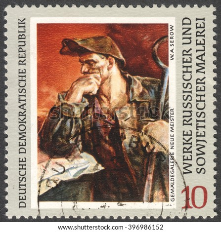 """MOSCOW, RUSSIA - CIRCA FEBRUARY, 2016: a stamp printed in DDR shows a painting """"Steel-worker"""" by Serov, the series """"Russian Paintings"""" circa 1969 - stock photo"""