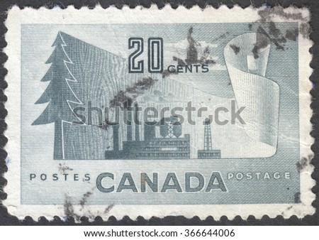 "MOSCOW, RUSSIA - CIRCA JANUARY, 2016: a post stamp printed in CANADA shows image of a tree and an industrial plant, the series ""Industry - Paper Production"", circa 1952 - stock photo"