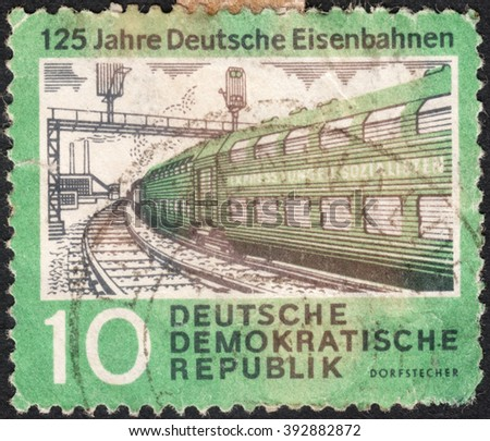 "MOSCOW, RUSSIA - CIRCA JANUARY, 2016: a post stamp printed in DDR shows a train, the series ""The 125th Anniversary of Rail Roads"", circa 1960 - stock photo"