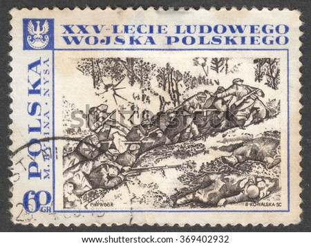 "MOSCOW, RUSSIA - CIRCA JANUARY, 2016: a post stamp printed in POLAND shows a battle scenery, the series ""The 25th Anniversary of the Polish People's Army"", circa 1968"