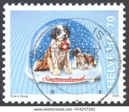 """MOSCOW, RUSSIA - CIRCA MAY, 2016: a post stamp printed in SWITZERLAND shows a St. Bernard dog, the series """"Snow Globes"""", circa 2000 - stock photo"""
