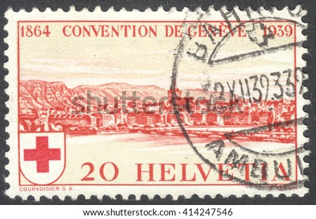 MOSCOW, RUSSIA - CIRCA MAY, 2016: a post stamp printed in SWITZERLAND shows a view of Geneva, dedicated to the 75th Anniversary of the Founding of the International Red Cross Society, circa 1939 - stock photo