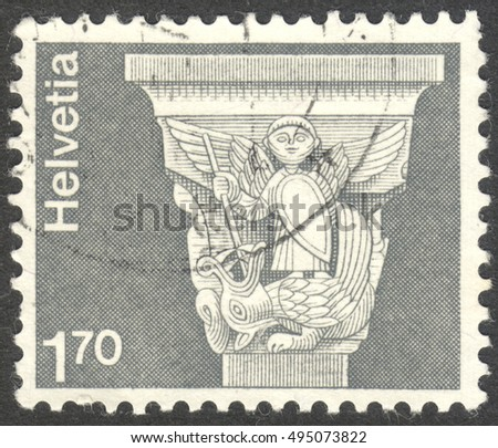 "MOSCOW, RUSSIA - CIRCA OCTOBER, 2016: a post stamp printed in SWITZERLAND shows Roman capital, St.-Jean-Baptiste Church, Grandson, the the series ""Architecture and Handicrafts"", circa 1973"