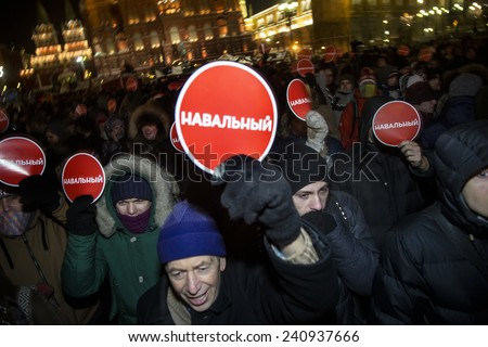 MOSCOW, RUSSIA - DEC 30: A group of people holds banners with name of opposition leader Alexei Navalny at Manezhnaya Square on unsanctioned rally on 30 of December 2014 in center of Moscow  - stock photo