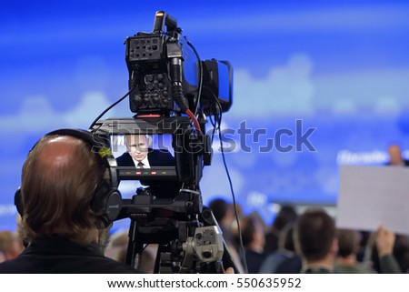 MOSCOW, RUSSIA - DEC 23, 2016: Center of international trade. Videographer at the annual press conference of the President of Russia, will broadcast the answers to the questions of Vladimir Putin