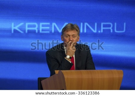 MOSCOW,RUSSIA - DEC 18: President Vladimir Putin's spokesman Dmitry Peskov seen attending the President's annual big press conference at the World Trade Center in Moscow on 18 December of 2014 - stock photo
