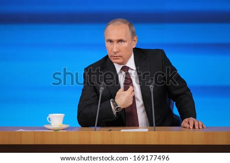 MOSCOW, RUSSIA - DEC 19, 2013: The President of the Russian Federation Vladimir Vladimirovich Putin annual press conference in Center of international trade - stock photo