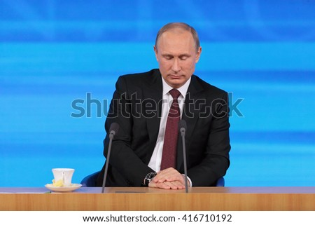 MOSCOW, RUSSIA - DEC 19, 2013: The President of the Russian Federation Vladimir Vladimirovich Putin with eyes closed annual press conference in Center of international trade - stock photo