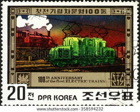 """MOSCOW, RUSSIA - DECEMBER, 2015: a post stamp printed in the NORTH KOREA shows a train, the series """"The 100th Anniversary of First Electric Train"""", circa 1980 - stock photo"""