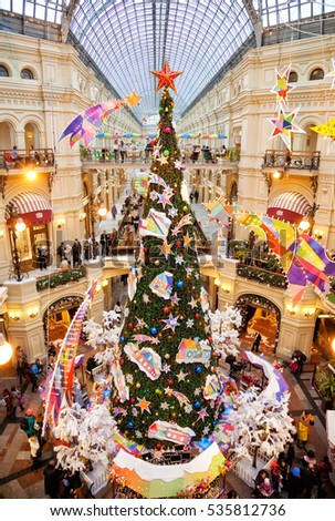 MOSCOW, RUSSIA - December 10: Christmas tree and decorations on the Christmas fair in GUM on December 10, 2016 in Moscow. GUM is large shopping mall in the center of Moscow.