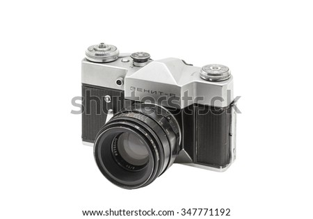 MOSCOW/RUSSIA - DECEMBER , 2015; Illustrative Editorial old soviet film camera Zenit - V with lens Helios 44-2, isolated on white background.  Soviet reflex camera, produced from 1968 - 1973