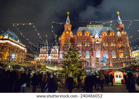 MOSCOW, RUSSIA - DECEMBER 24, 2014:  Manezhnaya square at night decorated for New Year and Christmas holidays. Christmas fair (market). Moscow, Russia. - stock photo