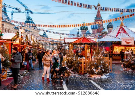 Moscow, Russia - December, 2015: People on Christmas market on Red Square in Moscow city center, Decorated and illuminated Red Square for Christmas in Moscow.