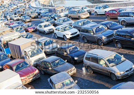 MOSCOW, RUSSIA - - FEBRUARY 8, 2012: Big transport stopper. Road jams arise because of a large number of transport which exceeds the maximum capacity of roads in the city  - stock photo