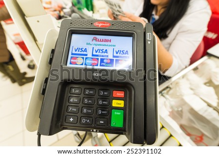 Moscow, Russia, February 1, 2015: Cash register, and a supermarket customers paying their shopping to cashiers