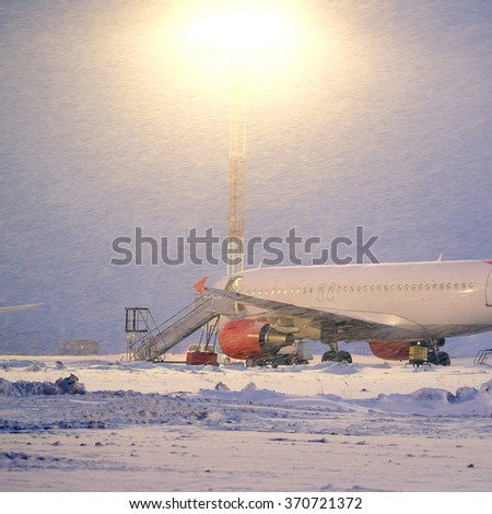 Moscow, Russia, February, 09,2015: commercial airplane parking at the airport in winter - stock photo