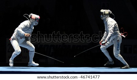 MOSCOW, RUSSIA - FEBRUARY 13: Eun Sok Oh (KOR) and Luigi Samele (ITA) compete at the 2010 RFF Moscow Saber World Fencing Tournament, February 13, 2010 in Moscow, Russia. - stock photo