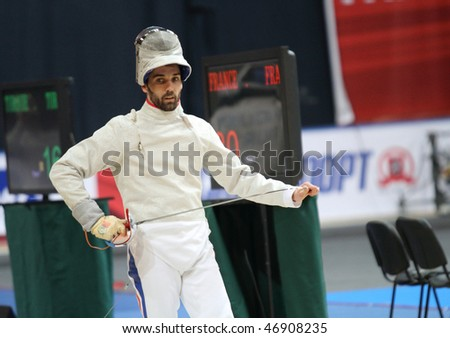 MOSCOW, RUSSIA - FEBRUARY 14: Nicolas Lopez (FRA) compete at the 2010 RFF Moscow Saber World Fencing Tournament, February 14, 2010 in Moscow, Russia. - stock photo