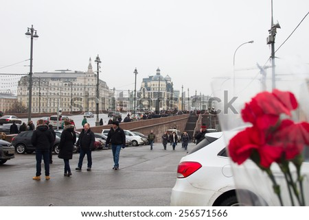 Moscow, Russia - February 28, 2015. People bring flowers to the site of the murder of politician Boris Nemtsov - stock photo
