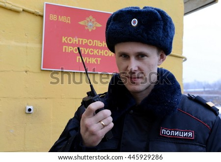 MOSCOW, RUSSIA - FEBRUARY 17, 2014:The duty of the checkpoint reports on the radio.