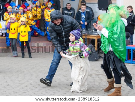 MOSCOW, RUSSIA - FEBRUARY 22: Unidentified man helps to run on Russian religious and folk holiday Maslenitsa near Culture center Peresvet on February 22, 2015, Russia - stock photo