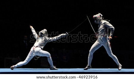 MOSCOW, RUSSIA - FEBRUARY 16: Women's national teams of Ukraine and China compete at the 2010 RFF Moscow Saber World Fencing Tournament, February 16, 2010 in Moscow, Russia. - stock photo