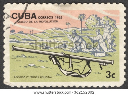 """MOSCOW, RUSSIA - JANUARY, 2015: a post stamp printed in CUBA shows a bazooka gun and soldiers, the series """"Museum of the Revolution"""", circa 1965 - stock photo"""
