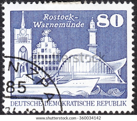 "MOSCOW, RUSSIA - JANUARY, 2016: a post stamp printed in DDR  shows attractions Kroepeliner Tor, Sonne Haus in Rostock and Teepott and lighthouse in Warnemuende, series ""New Daily Stamps"", circa 1974"