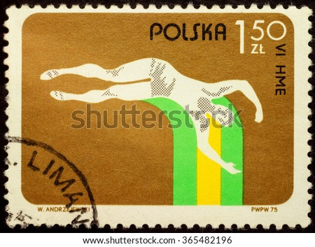 "MOSCOW, RUSSIA - JANUARY 21, 2016: a stamp printed in Poland shows jumping athlete, series ""The 6th Championship Light Indoor Athletics (Track and Field) in  Katowice, Poland"", circa 1975 - stock photo"
