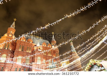 MOSCOW, RUSSIA- JANUARY 07, 2016:Christmas holidays illumination and State Historical Museum at night, near the Kremlin  in Moscow, Russia.Historical Museum-- inscription in Russian on the building    - stock photo