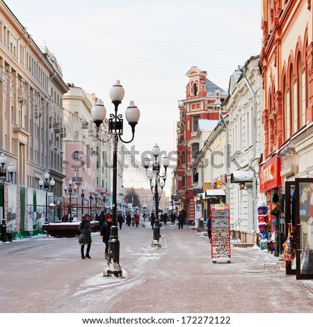 MOSCOW, RUSSIA - JANUARY 19, 2014: people, souvenir shops on Arbat street in Moscow. Arbat has existed since 15th century, it is pedestrian street about one km long in historical centre of Moscow