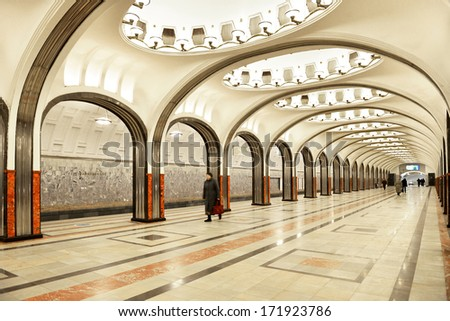 MOSCOW,RUSSIA-JANUARY 16:People walking at metro station on January 16,2014 in Moscow,Russia.It's rapid transit system serving Moscow.As of 2013,metro has 190 stations and its route length is 317.5 km - stock photo