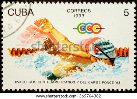 "MOSCOW, RUSSIA - JANUARY 22, 2016: stamp printed in Cuba shows swimming athlete, series ""The 17th Central American and Caribbean Games - Ponce, Puerto Rico"", circa 1993 - stock photo"