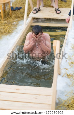 Moscow, RUSSIA - JANUARY 19: Swimming orthodox in the ice-hole, celebration of Epiphany (Holy Baptism) in the Orthodox tradition, January 19, 2014 in Moscow, Russia.