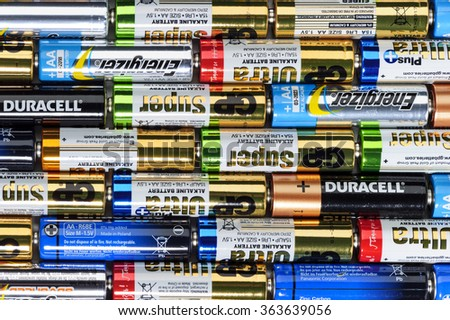 Moscow, Russia - January 05, 2016: Used alkaline batteries AA size format of different brands ready for recycling lying in a rows. Studio shot.  - stock photo