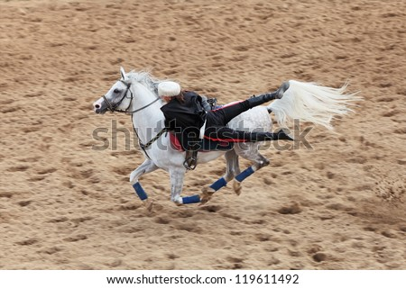 MOSCOW, RUSSIA - JUL 07: Demonstration performances - trick riding during races for the prize of the President of the Russian Federation on Jul 07, 2012 in Moscow.
