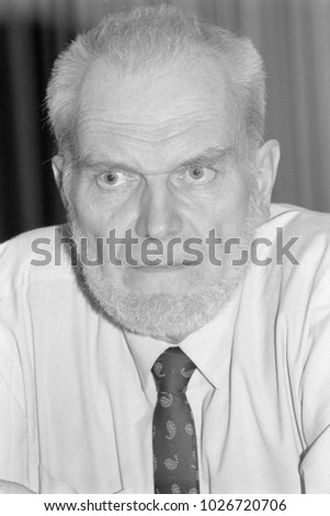 Moscow, Russia - July 23, 1993: Alexey Vladimirovich Yablokov, environmental adviser to russian President Boris Yeltsin in his office. Scan of black and white negative film.