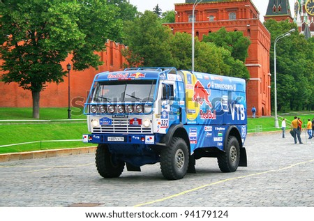 MOSCOW, RUSSIA - JULY 10: Anton Shibalov's KamAZ-4326 (No. 332, team KAMAZ Master) competes at the annual Rally Silkway - Dakar series on July 10, 2011 on the Red Square, Moscow, Russia. - stock photo