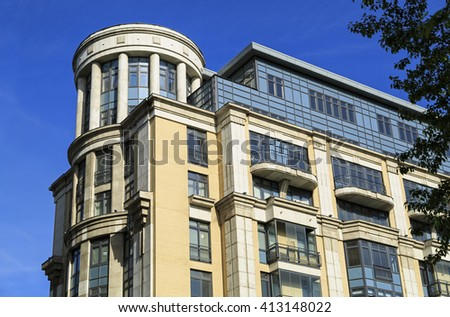 MOSCOW, RUSSIA - JULY, 16. Detail of the facade of the corner building of the new residential complex Four suns in the center of Moscow, Russia on July 16, 2015. - stock photo
