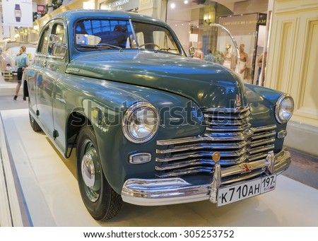"MOSCOW, RUSSIA-JULY 11: Exhibition of Soviet vintage cars in the store GUM August 11, 2015. The legendary Soviet car ""Pobeda"" is produced at the Gorky Automobile Plant in 1946-1958 years"