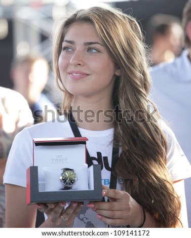 "MOSCOW, RUSSIA - JULY 28: Girl holding prize for winners during International Street Basketball Cup ""Moscow Open"" in Moscow, Russia at July 28, 2012"