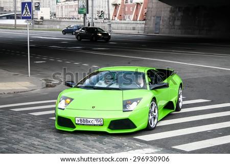 MOSCOW, RUSSIA - JULY 9, 2011: Green supercar Lamborghini Murcielago at the city street. - stock photo