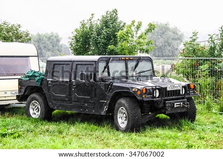 MOSCOW, RUSSIA - JULY 10, 2011: Off-road vehicle Hummer H1 at the countryside during a heavy rain. - stock photo